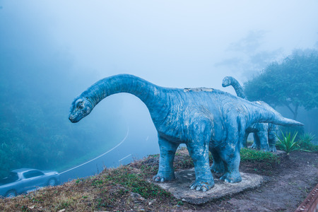Model of Chiang Muang dinosaur with mist at Phayao province, Thailand.