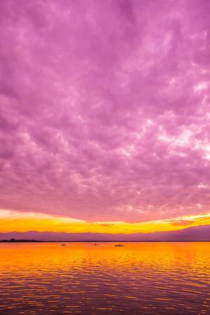 Sunset at Kwan Phayao, Thailand. Stock Photo