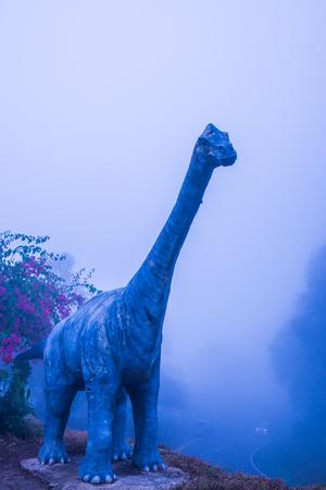 fibra de vidrio: Model of Chiang Muang dinosaur with mist at Phayao province, Thailand.