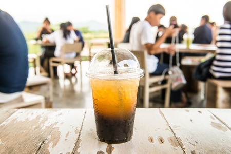Iced Honey Lemon Oolong in Plastic Glass, Thailand.