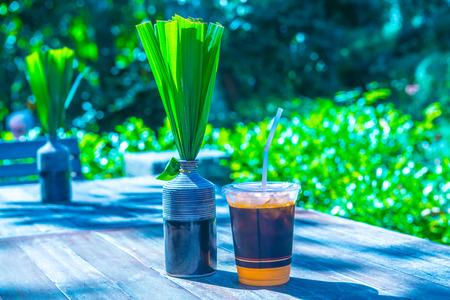 Iced milk tea with modern vase on the table, Thailand.