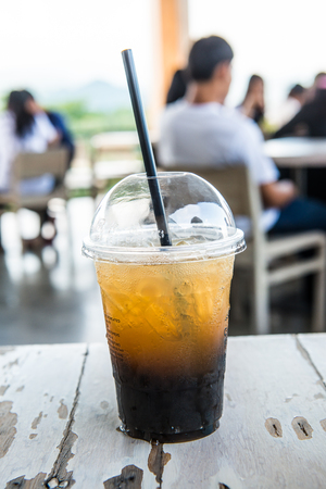 Iced Honey Lemon Oolong in Plastic Glass, Thailand.