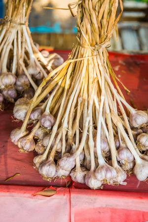 spiciness: Fresh garlic on red cloth, Thailand.