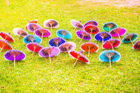 Thai native umbrella on grass, Thailand. Фото со стока