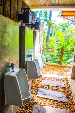 Urinals in men toilet, Thailand.