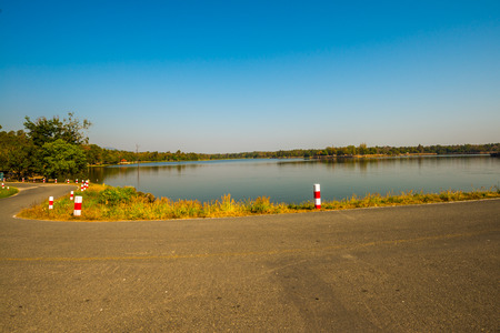 Road beside Huay Tueng Tao lake in Chiangmai province, Thailand. Stock Photo