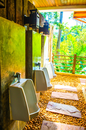 gents: Urinals in men toilet, Thailand.