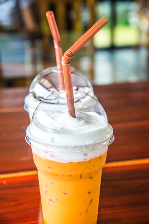 Iced milk tea in plastic cup, Thailand.
