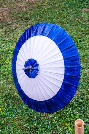 Thai native umbrella on ground, Thailand.
