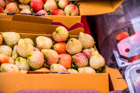 deatil: Young strawberries in paper box, Thailand.
