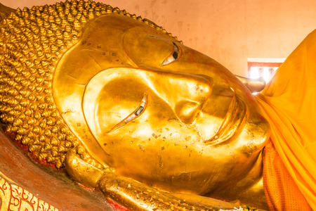 Face of Golden Reclining Buddha, Thailand.