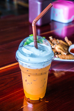 Iced milk tea in plastic cup, Thailand.