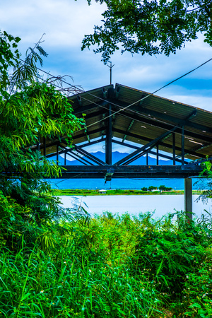 Public rest house at lakeside, Thailand.