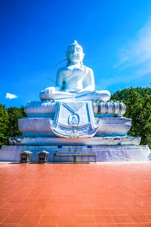 White buddha statue under construction at Phra That Maeyen temple, Thailand.