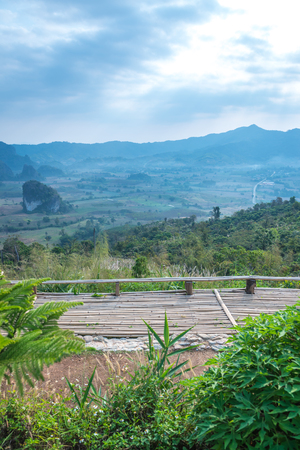 Wooden terrace with beautiful mountain view at Phu Langka national park, Thailand.