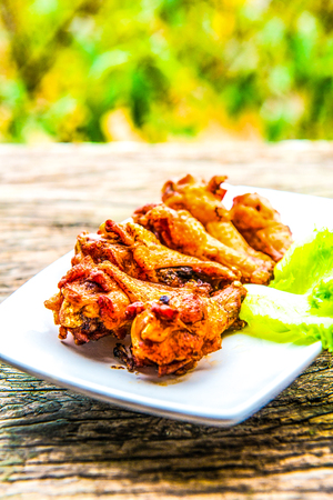 Thai style fried chicken on wooden panel, Thailand Stock Photo