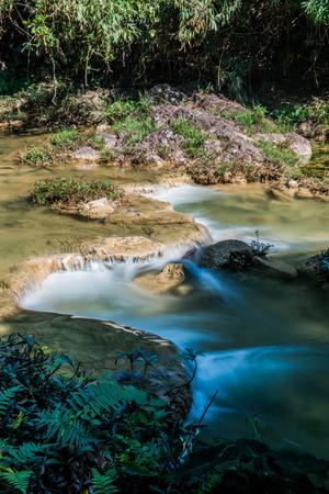 Water flowing in Doi Phu Nang national park, Thailand. Stock Photo