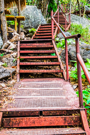 rusts: Steel stairs in forest, Thailand. Stock Photo