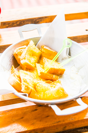 buttered: Buttered toast on aluminum bowl, THailand.