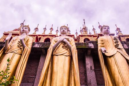 Standing Buddha statue in Phra That Suthon Mongkhon Khiri temple, Thailand.