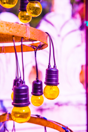Yellow electric lamp, Thailand.