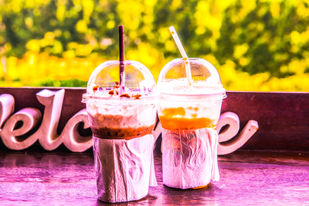 Iced Milk Tea and Iced Cocoa in Plastic Glass, Thailand.