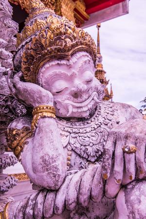 trabajo manual: Ancient giant statue in Phra That Suthon Mongkhon Khiri temple, Thailand. Foto de archivo