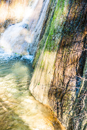 flowing water: Water flowing with tree shadow on stone, Thailand. Stock Photo