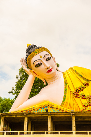 Beautiful reclining Buddha statue at Phra That Suthon Mongkhon Khiri temple, Thailand.