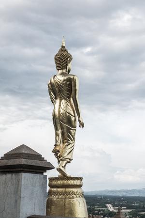 god walking: Walking buddha statue at Phra That Khao Noi temple, Thailand.