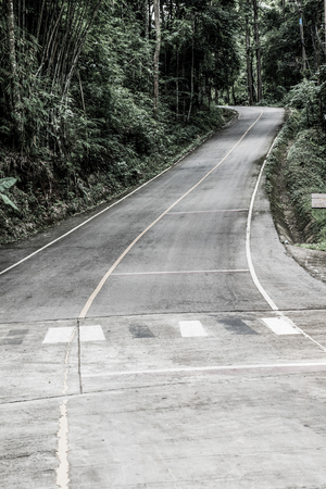 curve: Small road on mountain, Thailand.