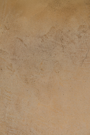 tough: Brown exposed concrete wall, Thailand.