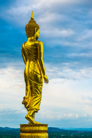 Walking buddha statue at Phra That Khao Noi temple, Thailand.