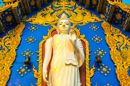 Standing buddha in Rong Suea Ten temple, Thailand. Stock Photo