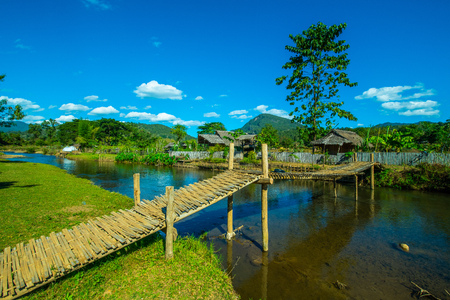 Bamboo bridge with small canal  in Mueang Khong district of Chiangmai province, Thailand. Banco de Imagens