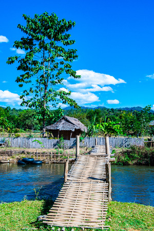 Small canal with mountain in Mueang Khong district, Thailand. Banco de Imagens