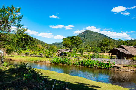 Small canal with mountain in Mueang Khong district, Thailand. Stockfoto
