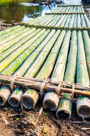 Bamboo raft beside the river in Mueang Khong district, Thailand. Фото со стока