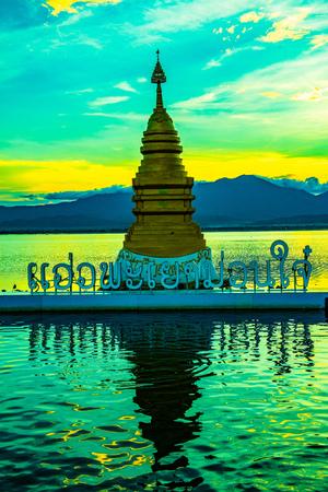 Golden pagoda at Kwan Phayao lake, Thailand.