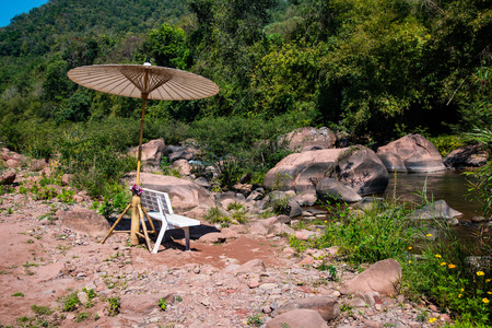 Small bench with Mang river in boklua district, Thailand.