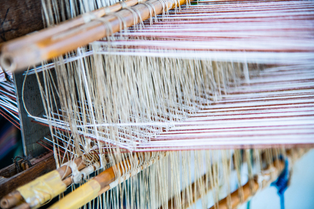 Native thread on Thai traditional weaving machine, Thailand.
