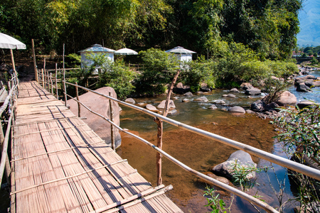 Small bridge with Mang river in boklua district, Thailand.