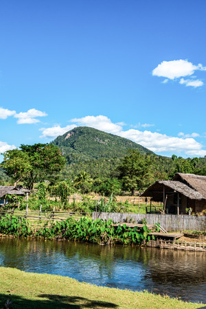 Small canal with mountain in Mueang Khong district, Thailand. Фото со стока
