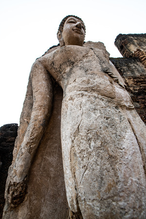Ancient Buddha statue in Phra Si Ratana Mahathat Chaliang temple, Thailand. Фото со стока - 122759744