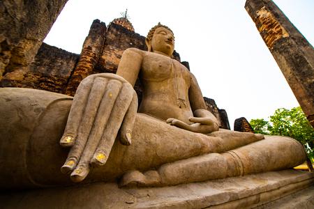 Ancient Buddha statue in Phra Si Ratana Mahathat Chaliang temple, Thailand.
