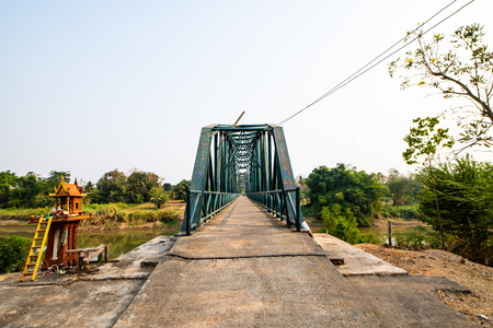 Iron bridge over the river in Sukhothai province, Thailand.