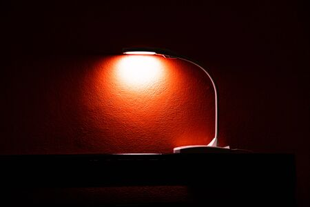The lamp with orange wall, Thailand.