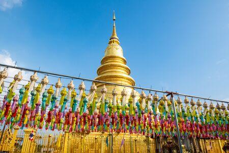 Phra That Hariphunchai pagoda with beautiful lantern in Lamphun Lantern Festival, Lamphun province. Stock Photo