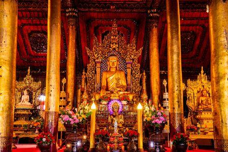 Old Buddha statue in Nantaram temple, Thailand. Stock Photo