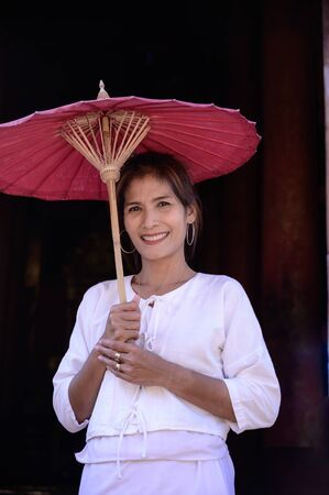 Thai woman with Lanna style background, Chiang Mai.